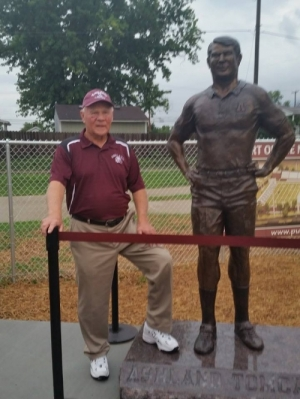 Herb Conley and the statue at Putnam Stadium in his honor. We are proud of our classmate!